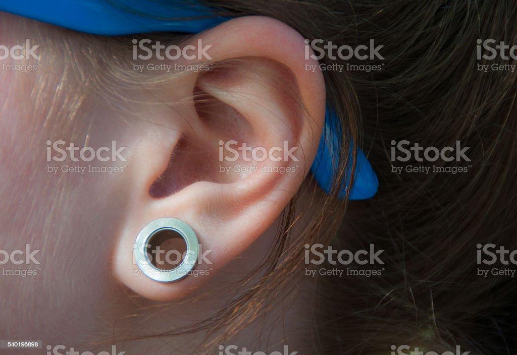 Piercing ear stock photo