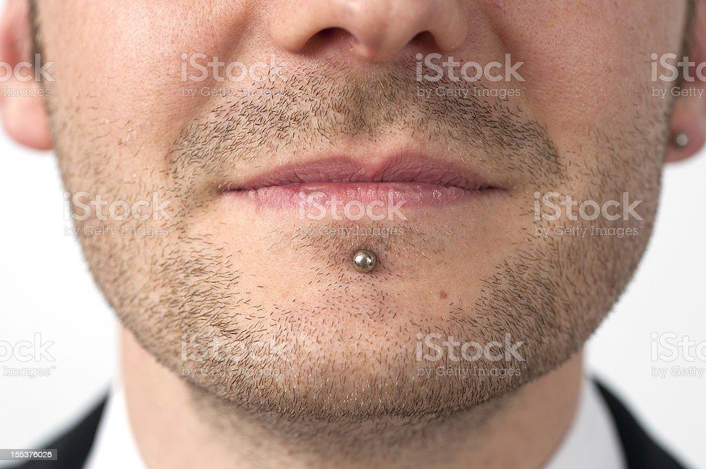 piercing in lips at businessman - Lippenpiercing bei Businessmann royalty-free stock photo