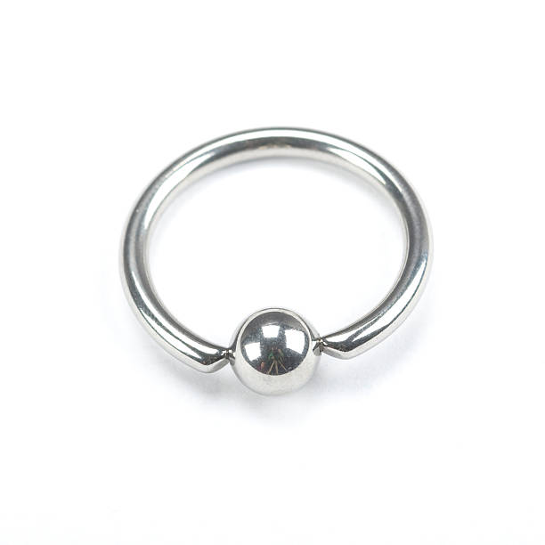 piercing - nose ring stock pictures, royalty-free photos & images