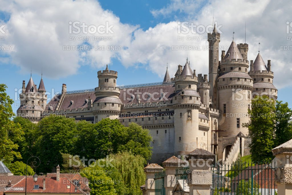 Pierrefonds Castle Pierrefonds, France - May 25 2020: The Pierrefonds Castle is an imposing castle located in the Oise department, in the Hauts-de-France region, on the south-eastern edge of the Compiègne forest. Architecture Stock Photo