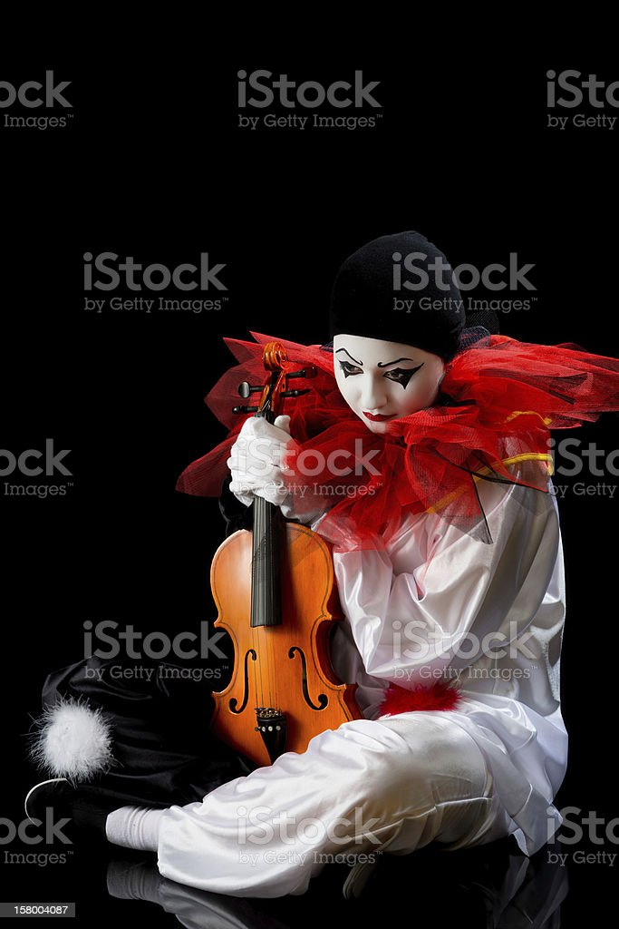 Pierrot with violin royalty-free stock photo