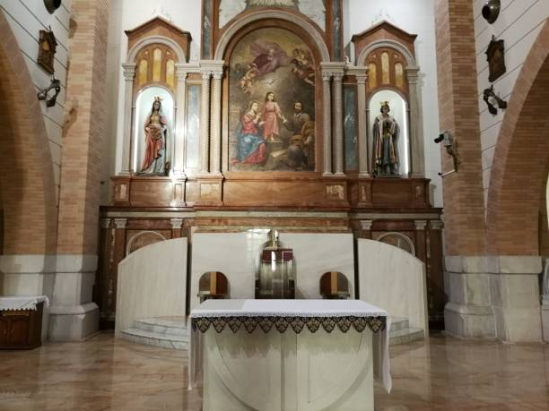 Pietrelcina - Altare della Sacra Famiglia Pietrelcina, Benevento, Campania, Italy - March 17, 2018: Altar of the Church of the Holy Family famiglia stock pictures, royalty-free photos & images