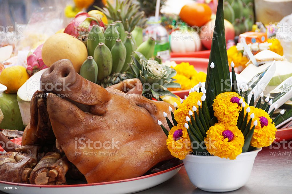 Pig head offered to the gods in a Thai temple stock photo