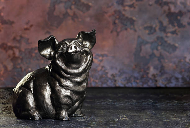 pig or boar on an abstract dark background. symbol of the new year. the concept of abundance, prosperity and wealth multiplication. selective focus, side view, copy space. - scrofa foto e immagini stock