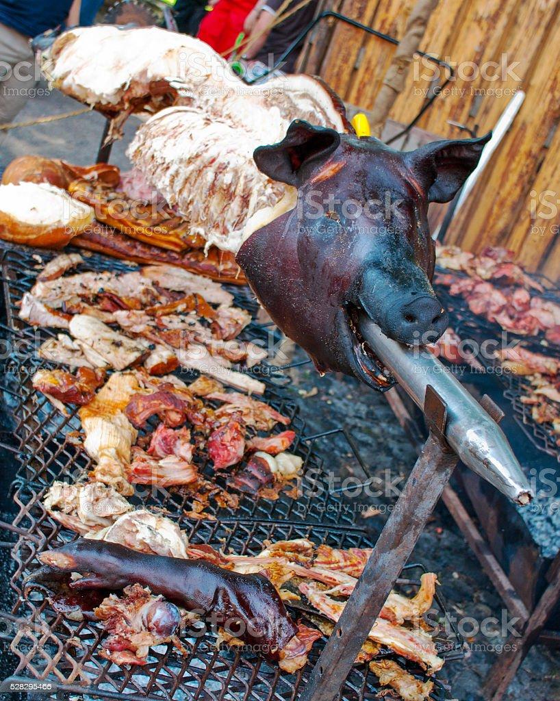 pig roast on the market stock photo
