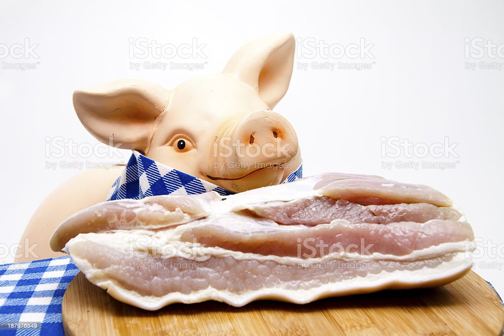 Pig with napkin and roast meat stock photo