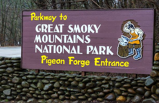Pigeon Forge entrance to Great Smoky Mountains National Park Pigeon Forge, USA - December 24, 2012: View of the sign at the Pigeon Forge entrance to Great Smoky Mountains National Park, this is a very popular tourist destination. pigeon forge stock pictures, royalty-free photos & images