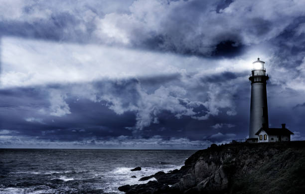 Pigeon Pt. lighthouse at night stock photo