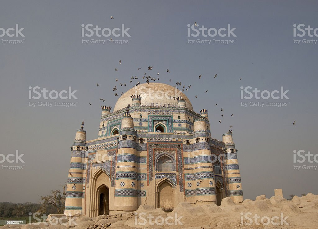 Pigeons and the Tomb of Uch stock photo