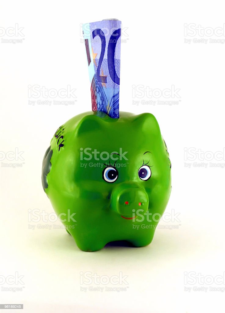 Piggy bank (green) and a bill of 20 euro royalty-free stock photo