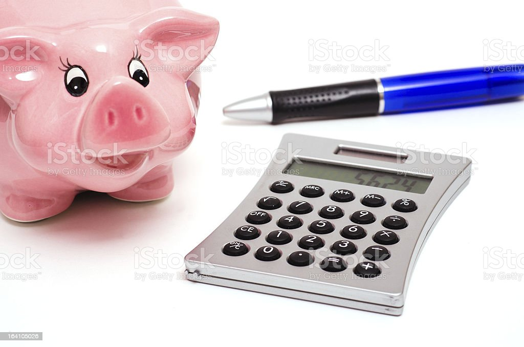 Piggy bank and a hand calculator royalty-free stock photo
