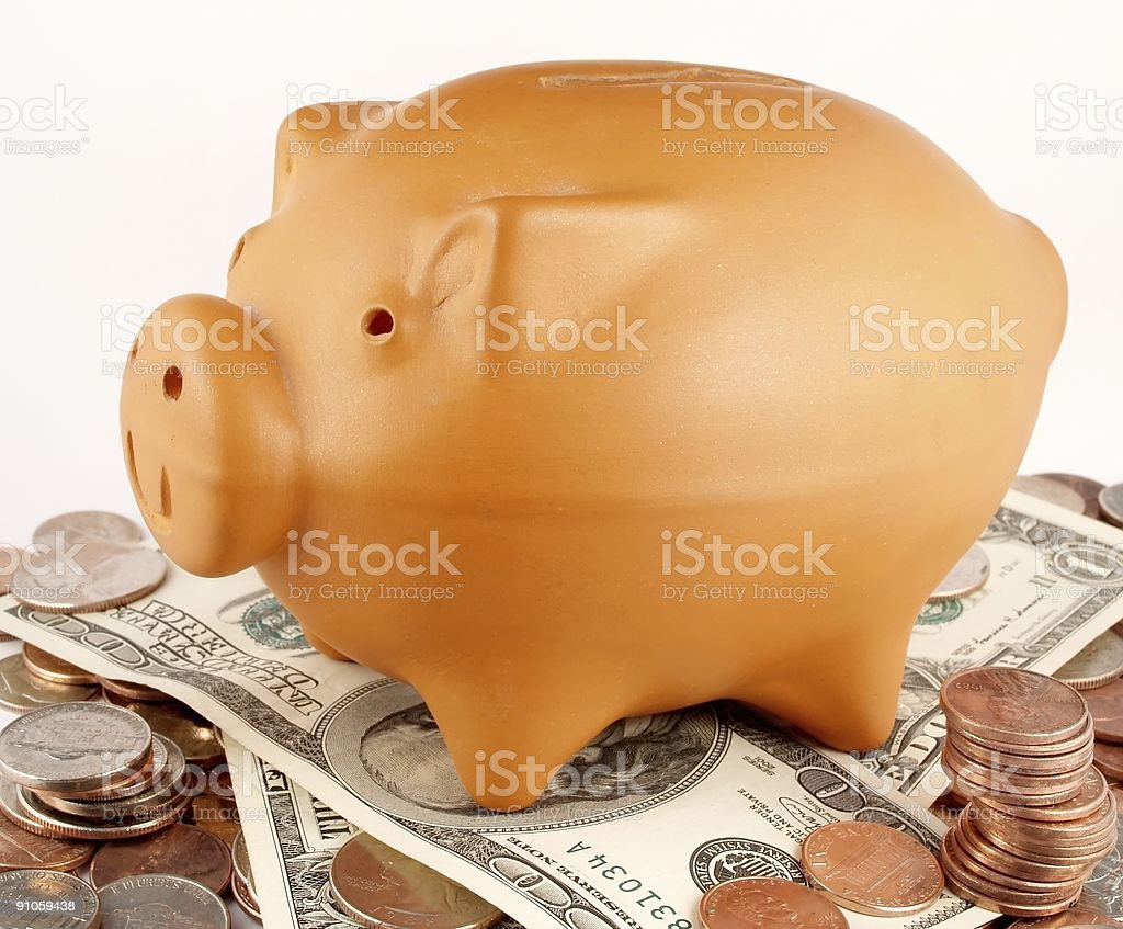 Piggy bank and cash stock photo