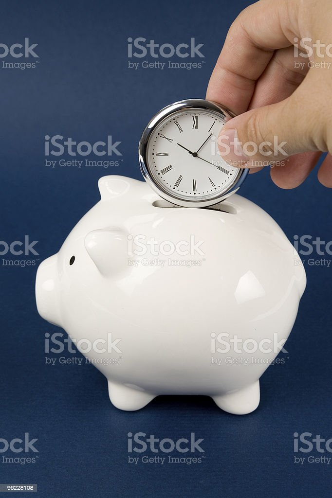 Piggy Bank and clock royalty-free stock photo