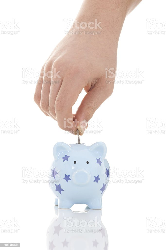 Piggy bank and hand with coin royalty-free stock photo