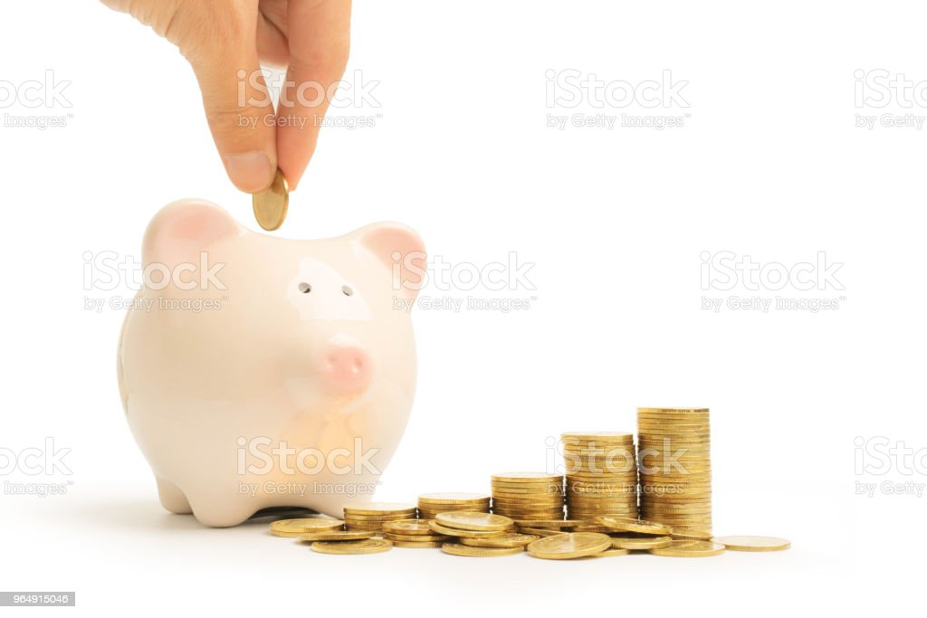 piggy bank and money tower isolated on white background royalty-free stock photo