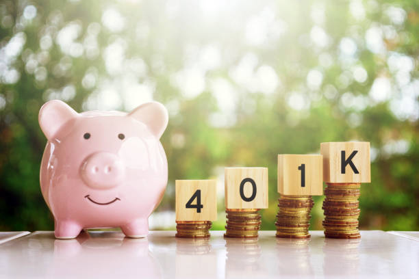 Piggy Bank and Wooden Blocks with Number 401k Business and finance concept. 401k stock pictures, royalty-free photos & images