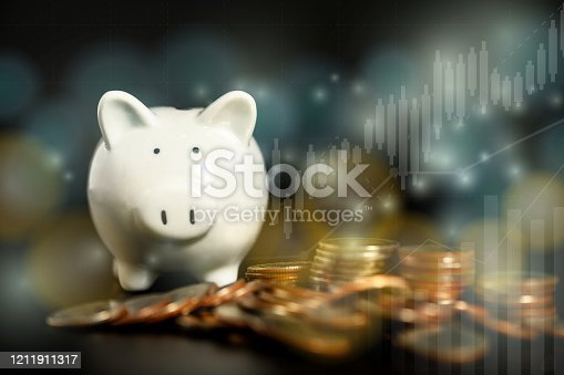 Piggy bank around with pile of coins with yellow-blue bokeh and financial graph, double exposure,  saving money concept