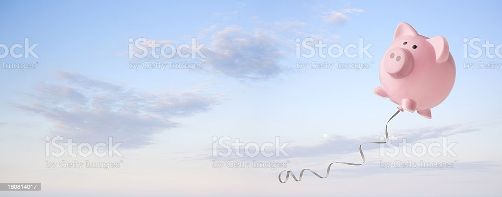Piggy bank balloon flying in the sky. stock photo