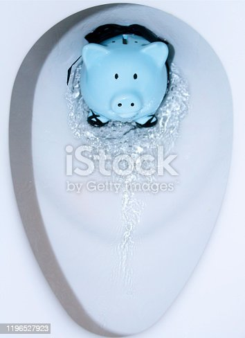 Pastel Blue Piggy Bank being flushed down toilet with water