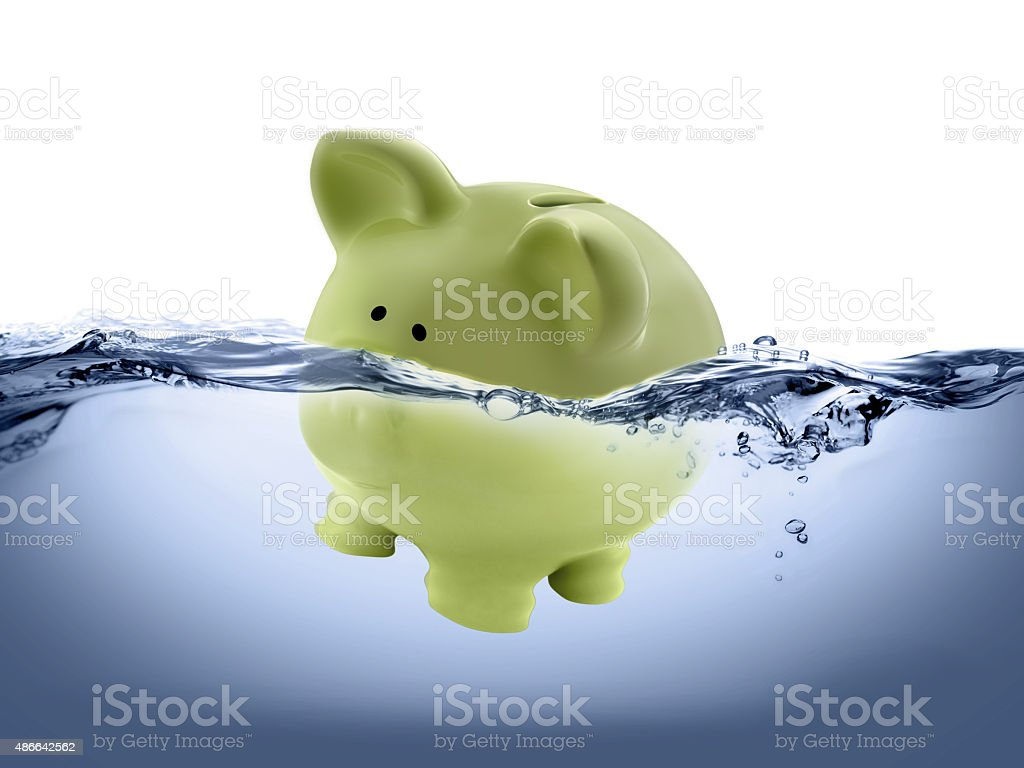 piggy bank drown in water stock photo