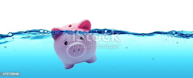 istock Piggy bank drowning in debt - savings to risk 475729046