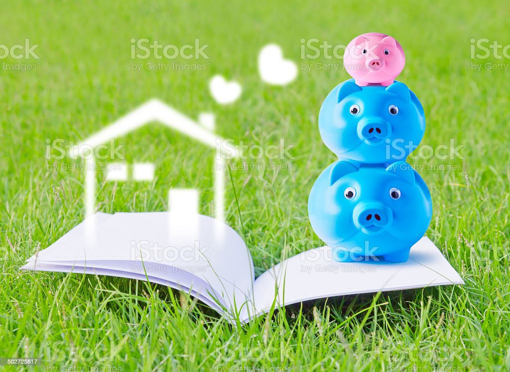 Piggy bank family on booklet for concepts in design work stock photo