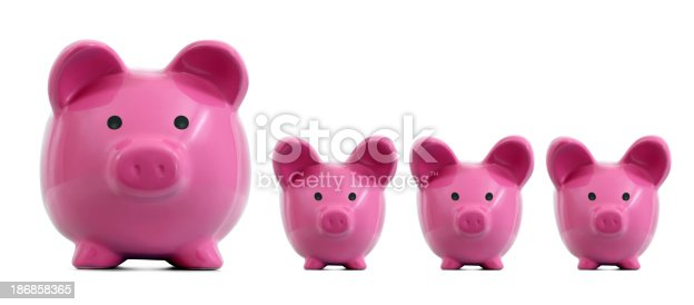 Pink piggy bank and her babies. Isolated on white background.