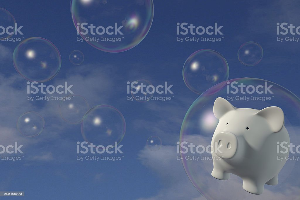 Piggy bank - Floating in a bubble stock photo