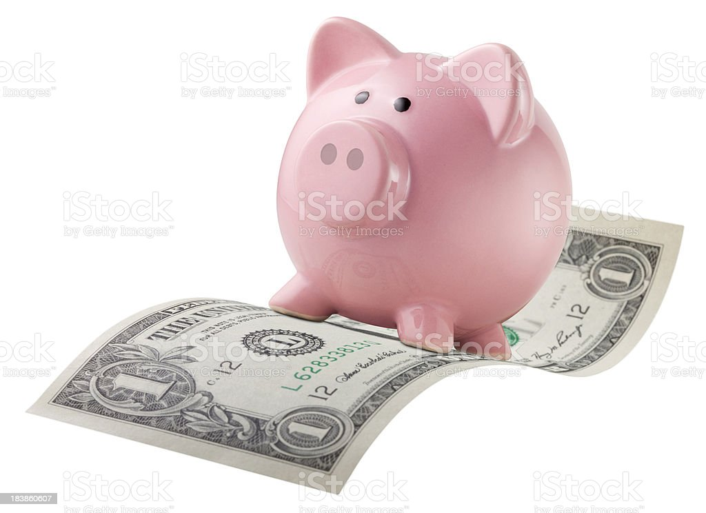 Piggy bank flying on a dollar bill. stock photo