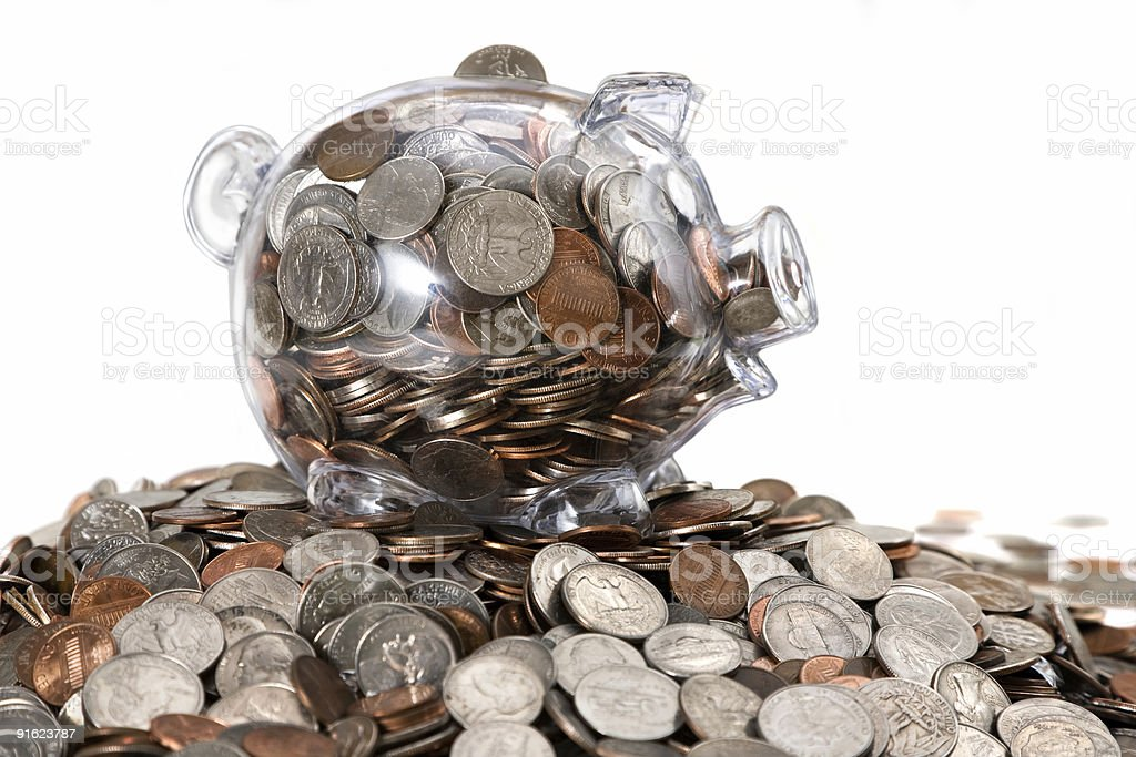 Piggy Bank Full Of Money on Top of Coin Mound royalty-free stock photo