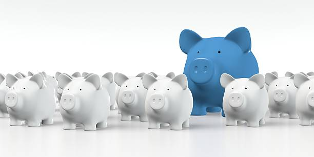 Piggy bank - Group with big blue pig stock photo