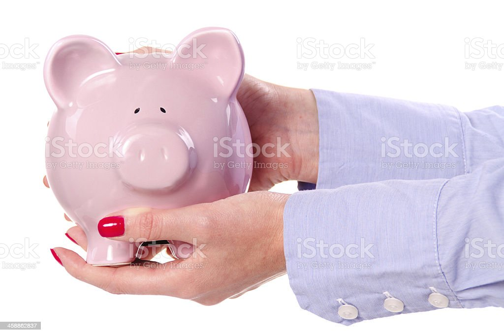 Piggy bank held in the women's hands stock photo