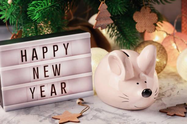 Piggy bank in the shape of a mouse lightbox with happy new year picture id1185946988?b=1&k=6&m=1185946988&s=612x612&w=0&h=causs ef ybkslncusl58ytao7encjoqi3umei925sa=