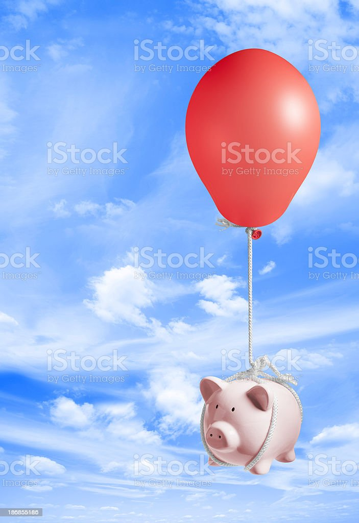 Piggy bank lifted up into sky by inflated balloon royalty-free stock photo