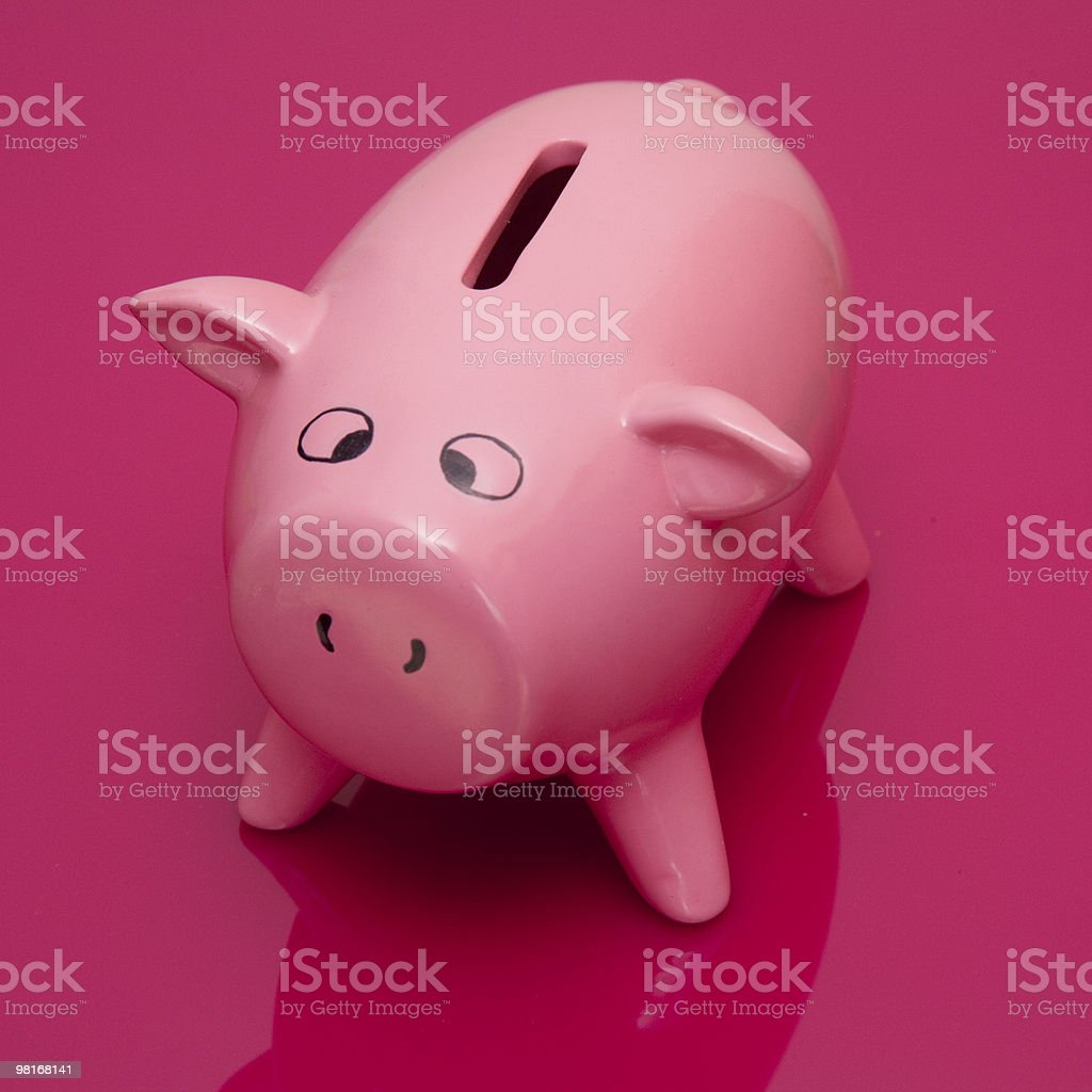 Piggy bank money box on a pink background. royalty-free stock photo