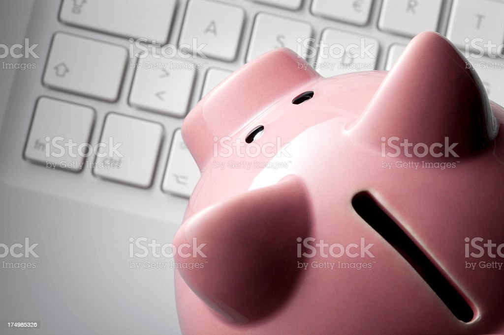 Piggy bank on a computer keyboard royalty-free stock photo