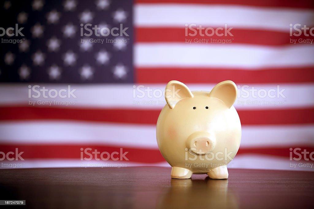 piggy bank on an American flag stock photo