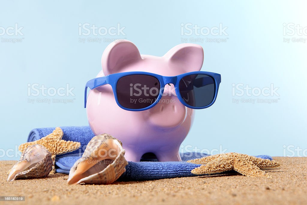 Piggy Bank on beach vacation royalty-free stock photo
