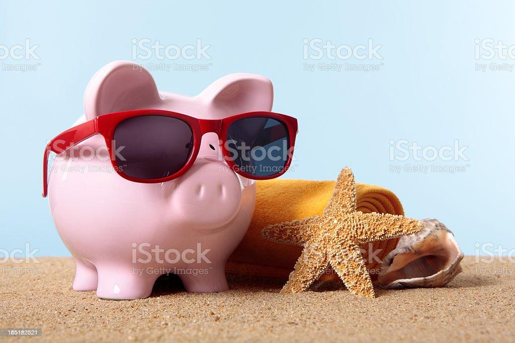 Piggy Bank on beach vacation royalty-free stock photo
