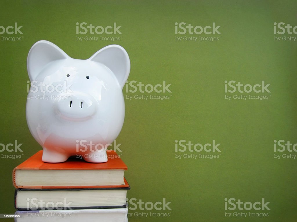 Piggy bank on books - college fund concept stock photo