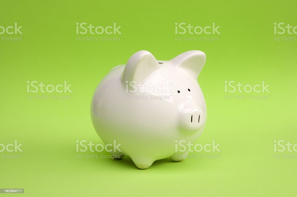 Piggy Bank on Green royalty-free stock photo