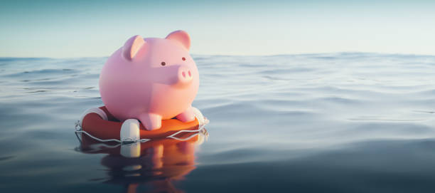 Piggy Bank On Lifebuoy, 3d Render Piggy Bank On Lifebuoy, 3d Render accidents and disasters stock pictures, royalty-free photos & images