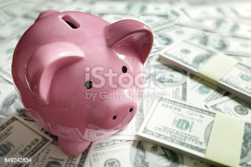 istock Piggy bank on money concept for business finance, investment and saving 849242834