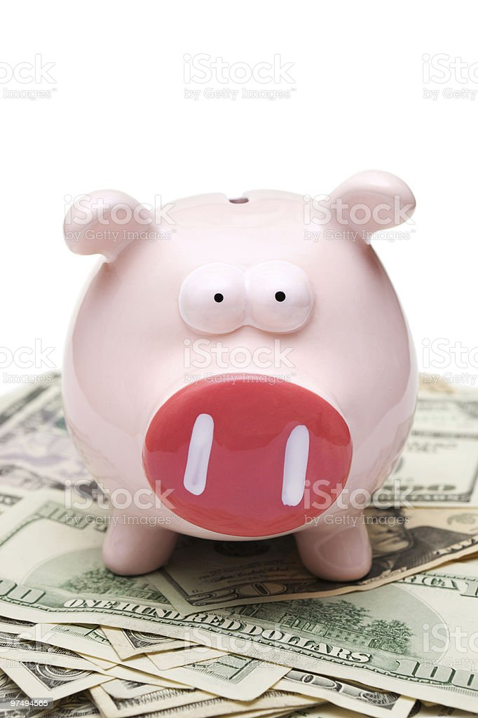 Piggy bank on money-white background royalty-free stock photo