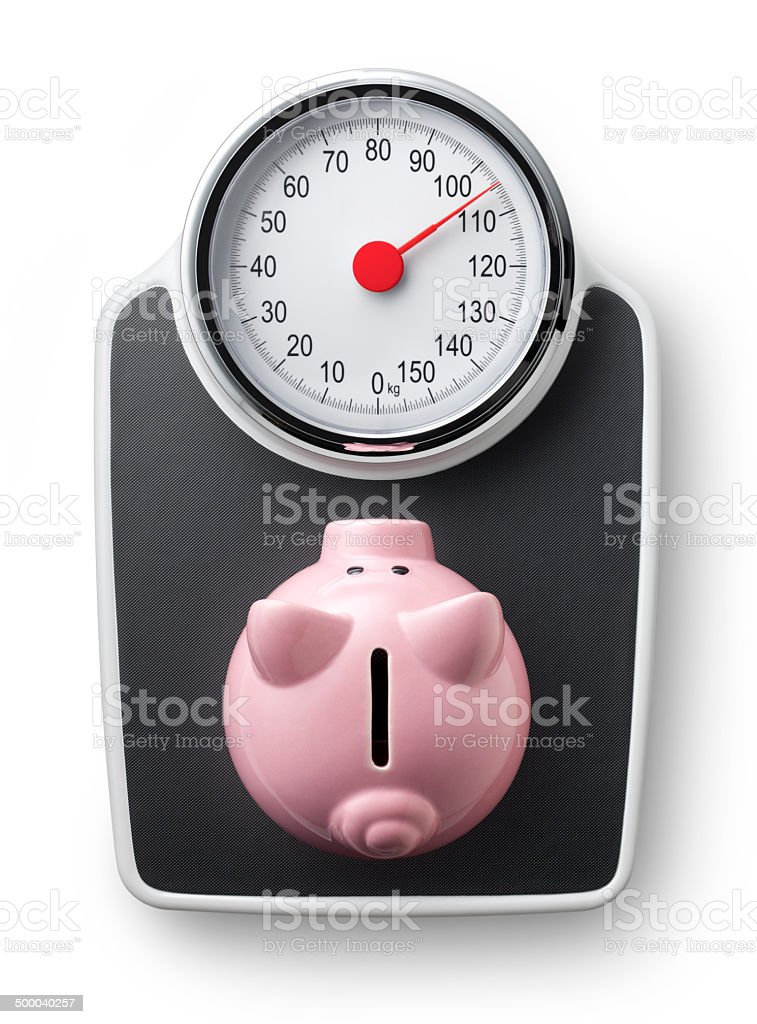 Piggy bank on scale. Concept image. stock photo