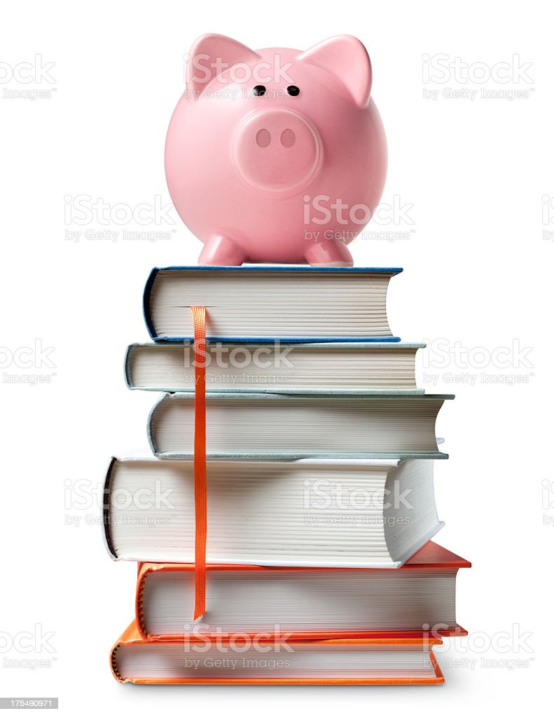 Piggy bank on stack of books stock photo