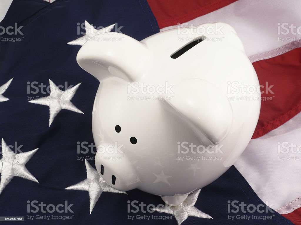 Piggy Bank Over American Flag royalty-free stock photo