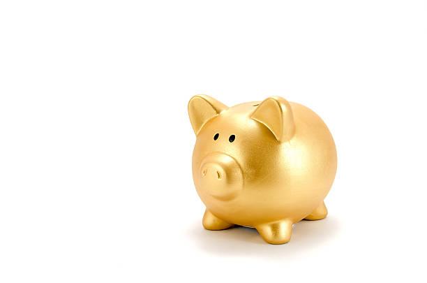 Piggy bank (Gold) stock photo