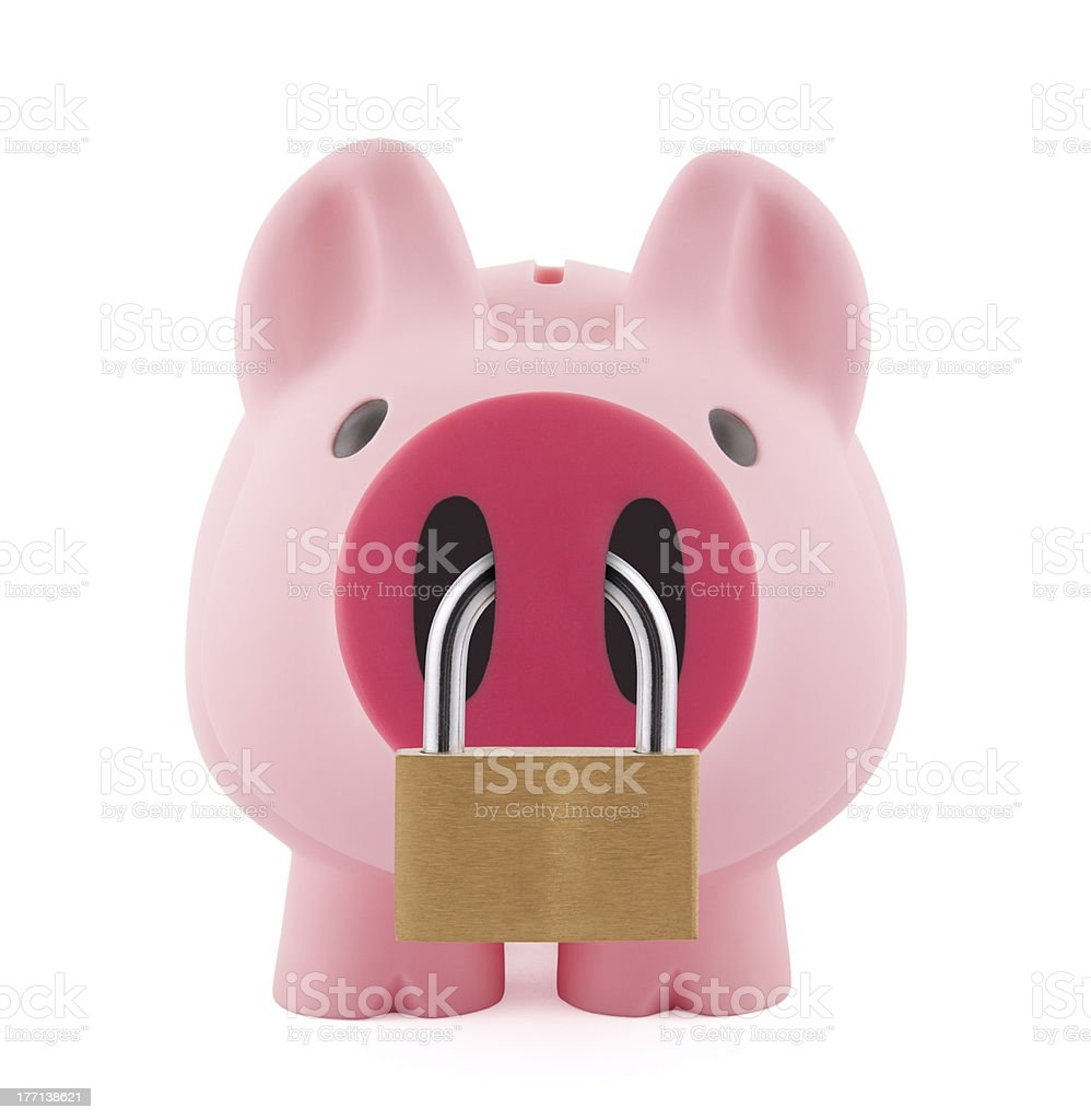 Piggy bank secured with padlock royalty-free stock photo