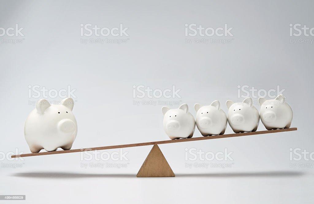 Piggy bank seesaw stock photo